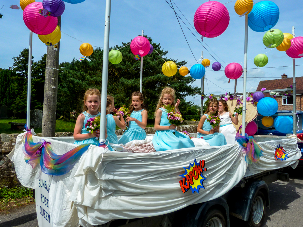 <h2>Summer 2020.  A Look back to 2019</h2><div class='slide-content'><p><span class='highlight'>Village Day Parade 2019: The 2018 Rose Queen attendants</span></p></div>