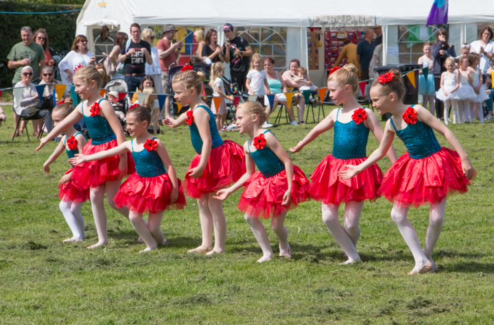 <h2>Bunbury village Day 2019</h2><div class='slide-content'><p><span class='highlight'>The Hanlon School Dancers prepare for their performance in the arena.</span></p></div>